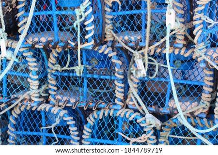 Heap of lobster pots in an harbor in Brittany Stok fotoğraf ©