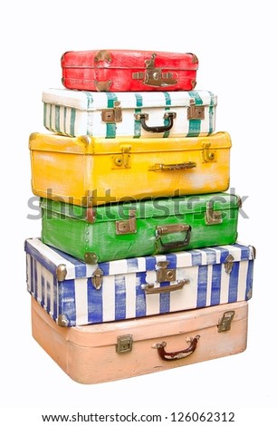 Heap of many-colored suitcases is on white background.