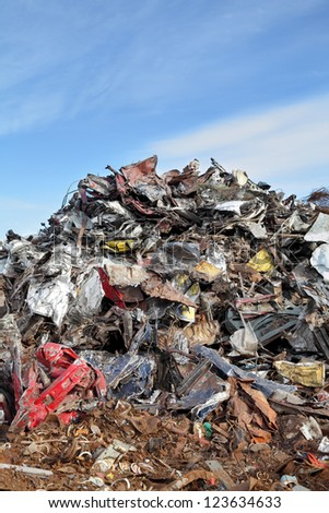 Heap of metal for recycling with blue sky