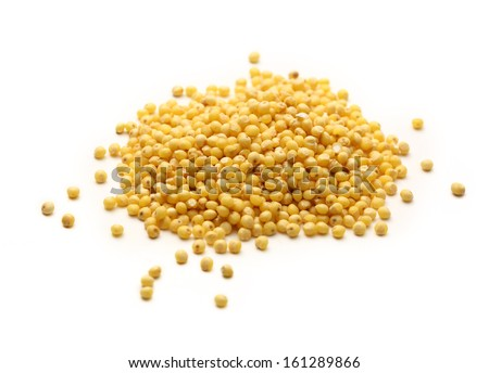 Heap of millet groats on white