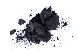 Heap of natural broken black activated charcoal granular and powder isolated on white background. Top view.