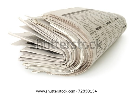 heap of newspapers in roll isolated on white