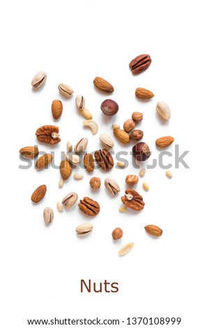 Heap of Nuts isolated on white background. Various nuts (almonds, pistachios, pecans, hazelnuts, pine nuts, peanuts).