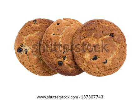 heap of oat cookies with raisins, isolated on white