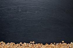 Heap of oatmeals downside frame on slate plate. Top view. Copyspace.