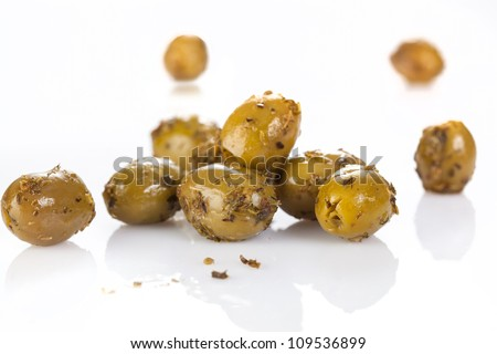 Heap of olives with seasoning on white background