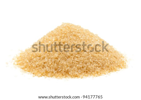 Heap of organic brown cane sugar over white background
