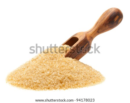 Heap of organic brown cane sugar with wooden scoop over white background - stock photo