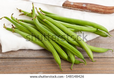 Heap of organic pole beans on wooden table