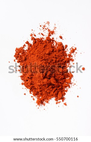 Heap of paprika. Isolated on white. Top view.