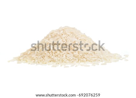 Heap of parboiled rice isolated on white background. Copy space, close up, high resolution product. Healthy food concept
