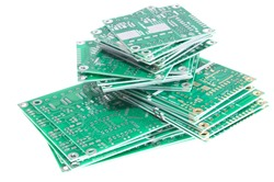 Heap of PCBs isolated on white background