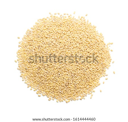 Heap of pearl barley isolated on white background close up. Raw dry pearled barley or pearl-barley cereals top view