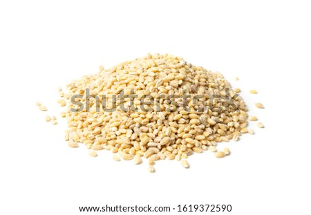 Heap of pearl barley isolated on white background close up. Raw dry pearled barley or pearl-barley cereals