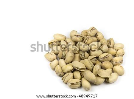 Heap of pistachios on white - stock photo
