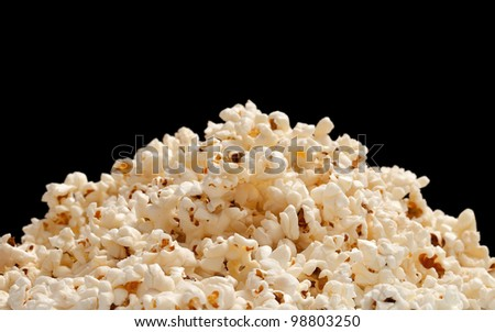 heap of popcorn isolated on black background.