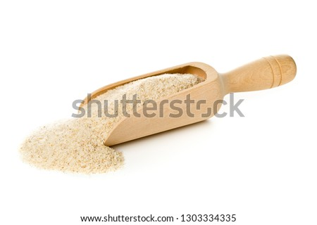 Heap of psyllium husk in wooden scoop over white background. Psyllium husk also called isabgol is fiber derived from the seeds of Plantago ovata plant found in India. Stock photo ©