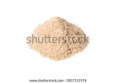 Heap of psyllium husk isolated on white background. Psyllium husk also called isabgol is fiber derived from the seeds of Plantago ovata plant found in India. Stock photo ©