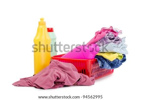 Heap of pure clothes with washing-up liquids