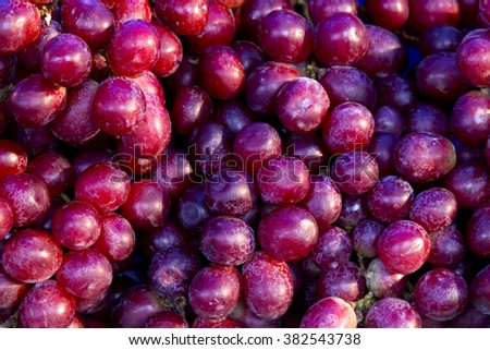 heap of purple grapes in the wooden basket