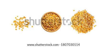 Heap of raw popcorn grains isolated on white background. Set of dry yellow corns seeds, maize or sweetcorn kernels top view