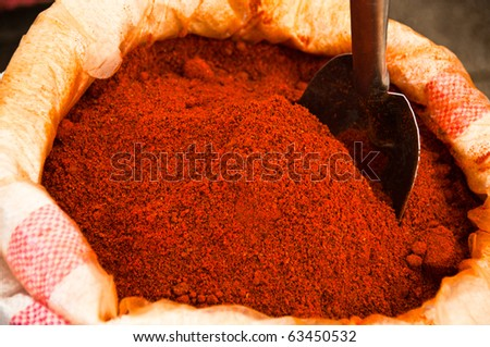 Heap of red ground paprika sold at Egypt Bazaar (MisirCarsisi) in Istanbul, Turkey - stock photo