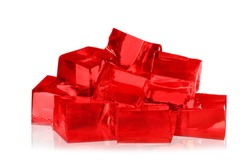 Heap of red jelly cubes on white background