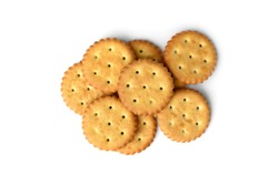 Heap of salt crackers isolated on white background. Top view.