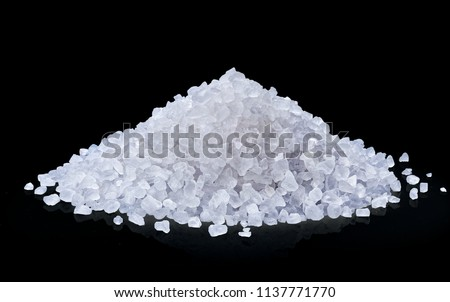 heap of salt isolated on black background with clipping path