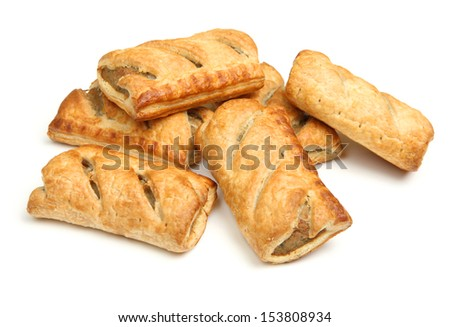 Heap of sausage rolls on white background.