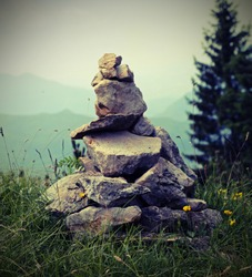 heap of stones called CAIRN in mountain. This stones are used such as trail markers to indicate the correct path
