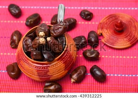 Free photos Heap of sweet dry fruit dates / Arabian Ramadan