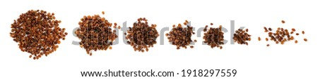 Heap of sweet raisins isolated on white background. Dried grapes pile, handful of dark brown raisin top view Stock photo ©