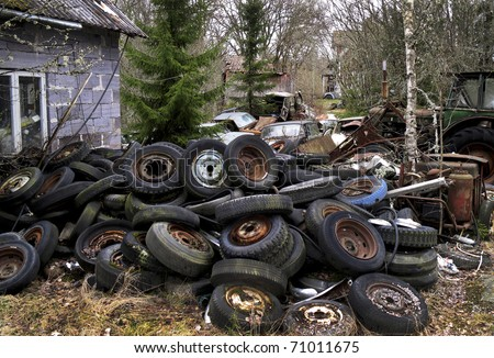 Heap of thrown tyres behind a breakers workshop. From the series scrap in the wood - Sweden near the Norwegian boarder.