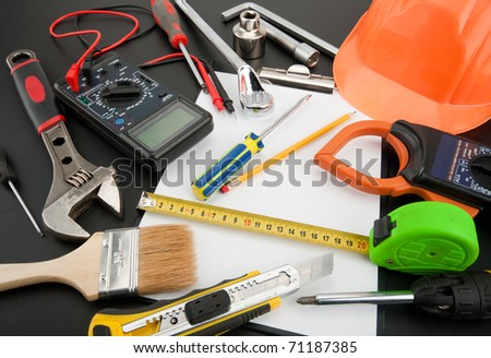 Heap of tools. Multimeter, spanner, wrench, helmet and other
