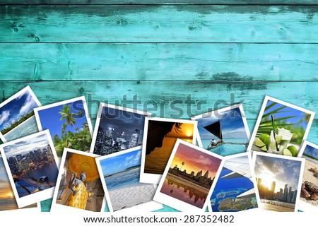 heap of travel photos on azure wood background