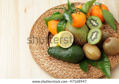 Heap of tropical fruits on a straw platter