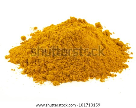Heap of turmeric on isolated white background