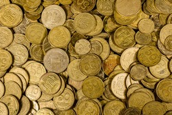 Heap of ukrainian coins for the background