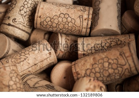 Heap of used vintage wine corks close-up.