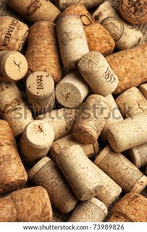 Heap of used vintage wine corks close-up.