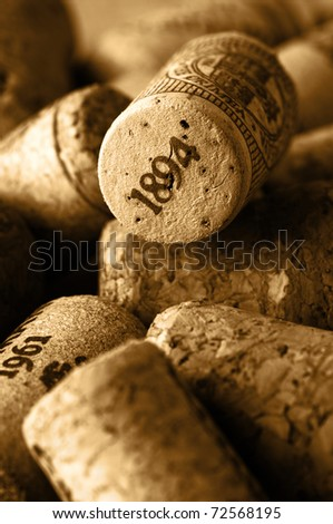 Heap of used vintage wine corks close-up. Toned image.