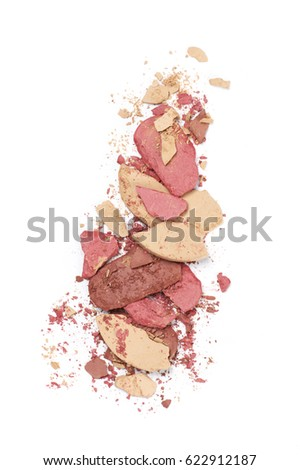 Heap of various crashed face powder, blushers and eyeshadow isolated on white background. Neutral colored makeup products. Top view point. #622912187