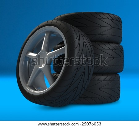 Heap of wheels with aluminium rims over the blue background