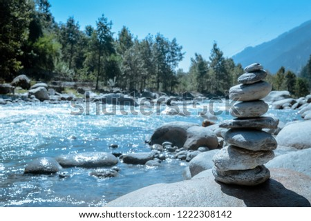 Heap of white stone stack of rock decoration in vertical style composition, copy space. Harmony, stability, strength, well being, concept. Useful in health, spa-therapy, alternative, medicine industry
