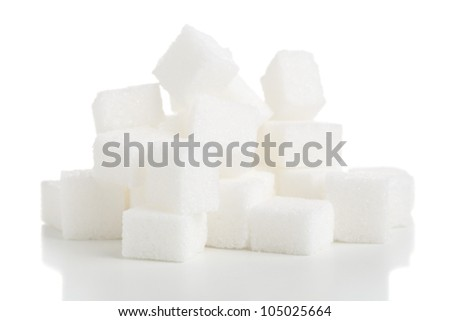 Heap of white sugar cubes over white background