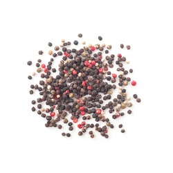 Heap of whole black, white, green and pink peppercorns