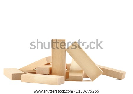 Heap of wooden blocks tower game isolated on white