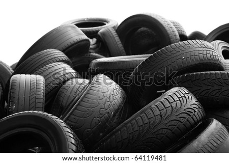 Heap of worn-out tires on white background