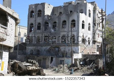Photo of  heap of wrecked houses destroyed by war and fierce fighting in al-Jahmaliya neighborhood in the eastof Taiz City, Yemen